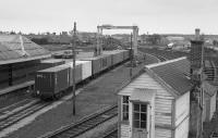 Looking over the GNSR yard at Elgin, past the disused signalbox.  A container train is under the gantry  To the right are some tank wagons with the former engine shed beyond.<br><br>[Bill Roberton&nbsp;//1991]