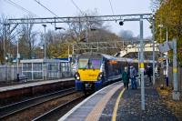 An Helensburgh to Edinburgh service draws to a stop at an autumnal Dalreoch.<br><br>[Ewan Crawford&nbsp;21/11/2016]