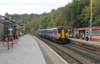 View from the Manchester platform at Todmorden as Northern 156420 slows to call with a Leeds service on 21st October 2016. <br><br>[Mark Bartlett&nbsp;21/10/2016]