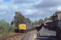 37088 is seen passing the location of the original Newburgh station with an Edinburgh - Inverness train on 19th September 1990.  Just visible above the 3rd carriage is the roof of a bungalow now occupying the site.<br><br>[Graeme Blair&nbsp;19/09/1990]