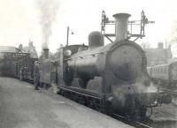 A pair of 1890s veterans waiting to take a Lockerbie train out of Dumfries in April 1949. Caley 'Jumbo' 57409 is the leading locomotive, with Webb LNWR 2-4-2T 46635 behind. Both were withdrawn from Dumfries shed early the following year.<br><br>[G H Robin collection by courtesy of the Mitchell Library, Glasgow&nbsp;18/04/1949]