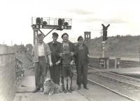 Three railwaymen, a friend, a boy, a dog and a historic old signal box. Posed portrait (names unknown) at the north end of Dumfries station in the summer of 1961. <br><br>[G H Robin collection by courtesy of the Mitchell Library, Glasgow&nbsp;15/07/1961]