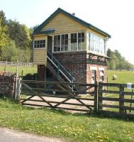 The surviving signal box at Cliburn, Cumbria, in May 2006. Located on the northern section of the Eden Valley line, the station closed to passengers in 1956 with the line itself closing completely 6 years later. View is east over the site of the old level crossing, with the former station building, now a private residence, located off picture to the right [see image 35003].<br><br>[John Furnevel&nbsp;11/05/2006]