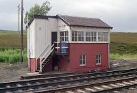 The 1909 signal box at Dalwhinnie in unmodified state in 1990. It has since been rebuilt. This box replaced north and south boxes here. The view of this box is obscured from the northbound platform by the base of the former water tank.<br><br>[Ewan Crawford&nbsp;//1990]