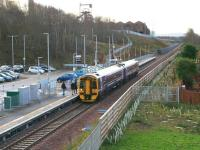 Passengers boarding the 0931 ScotRail service to Edinburgh at Newtongrange on 1 December 2016. I can't help wondering what the sapling survival rate is in the area to the right between the railway fence and the houses of Jenks Loan.<br><br>[John Furnevel&nbsp;01/12/2016]