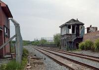 View west from the end of the (then) closed Maryhill station of the burned signal box and its replacement to the left.<br><br>[Ewan Crawford&nbsp;29/05/1987]