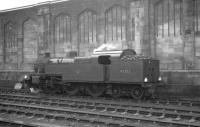 The Carlisle station pilot taking a break alongside the west wall on a Saturday morning in March 1964. Duty locomotive on this occasion is Fowler 2-6-4T 42353, finally withdrawn from Kingmoor shed three months later.<br><br>[K A Gray&nbsp;14/03/1964]