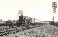 Black 5 45160 photographed just north of Falkland Junction on 6 August 1955 with an Ayr - Edinburgh Princes Street train.<br><br>[G H Robin collection by courtesy of the Mitchell Library, Glasgow&nbsp;06/08/1955]