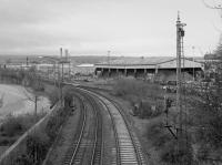 Looking to the site of Grangemouth station in 1987. The lines in the foreground run to the oil terminal (left) and Grange Dock (right). This was the location of Grangemouth No 3 box which controlled the approach to the many docks at Grangemouth. The view is from station road which originally crossed an earlier incarnation of the railway on the level.<br><br>[Bill Roberton&nbsp;//1987]