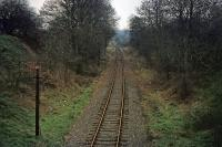 This stretch of track is part of what remained of the Watford to Rickmansworth (Church Street) line on 27th December 1975. The view is eastwards towards Croxley junction from an overbridge near Vicarage Road in Watford. The line was in sporadic use at the time for fuel oil deliveries to Croxley paper mill. The mill closed in 1980 and the trackbed now forms the Ebury Way. Early in its existence, there was a plan to connect this line to Edgware via Bushey and Elstree.<br><br>[Mark Dufton&nbsp;27/12/1975]
