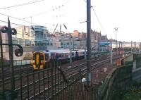 A weak sunrise over the east end of Waverley as the 0855 Edinburgh - Tweedbank crosses the bridge over Calton Road shortly after leaving platform 7 on Saturday 17 December 2016.<br><br>[Andy Furnevel&nbsp;17/12/2016]