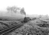 A fully loaded coal train from Minnivey Colliery approaching Dunaskin washery on the Waterside complex in 1972. The train is passing Burnton Loop - complete with shunter riding 'side-saddle'.<br><br>[John Furnevel&nbsp;04/03/1972]