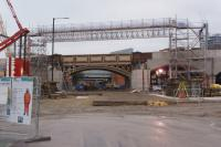 Looking north along Water Street with the first bridge carrying the Ordsall Jct (left) to Castlefields Jct line. The viaduct here is being widened to accommodate the south end of the new Ordsall Chord and two new bridge sections are waiting in a compound to the right to be lifted into place, possibly during an extended closure over Christmas and New Year, starting on the 18th.<br><br>[John McIntyre&nbsp;15/12/2016]
