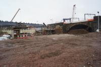 Bridges over the Irwell. The horizontal grey beam on the left is the start of the new bridge that will carry the Ordsall Chord over the river. On the right however is the original Stephenson bridge of the Liverpool and Manchester Railway. The missing parapet and cleaner stone was due to a later bridge being connected to it and only having recently been removed during the Ordsall Chord work.<br><br>[John McIntyre&nbsp;15/12/2016]