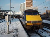 91017, with National Express branding over GNER livery, is seen newly arrived from Kings Cross in the snow at Leeds on 3rd February 2009. <br><br>[Mark Bartlett&nbsp;03/02/2009]