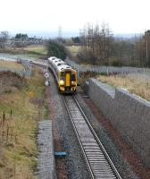 At 1022 on 18 December 2016, another one of those grey winter days when it never seems to achieve real daylight, the Sunday morning 0945 ex-Tweedbank comes off Hardengreen Viaduct and begins to slow for the Eskbank stop just behind the camera.<br><br>[John Furnevel&nbsp;18/12/2016]