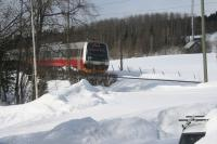 A Class 92 DMU of the Norwegian State Railways NSB comes into view on its way east. It was known as Nabotåget, the neighbour train and it ran from a suburb of Trondheim to Östersund Central. As the line had been closed at Stora Helvetet (a very steep-sided embankment which was showing signs of instabilty) from November 2013 to early 2015 the service was suspended and with tendering of rail services it looks unlikely to be restored when that part of the line is replaced by a bridge in 2018. It is only due to run from Storlien just on the Swedish side of the border to and from Trondheim.<br><br>[Charlie Niven&nbsp;04/04/2013]