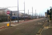 A murky morning at Haymarket Yards on 30 December 2016, with Haymarket station just off picture to the left. From left to right are the 0839 from Glenrothes with Thornton, the 0616 ex-Manchester Victoria and a city-bound tram from Edinburgh Airport.<br><br>[Andy Furnevel&nbsp;30/12/2016]