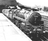 BR Standard class 5 4-6-0 73006 stands with a train at the south end of Perth station, thought to be in the 1950s. The locomotive had arrived at Perth shed new from Derby Works in June 1951 and remained here until January 1963. <br><br>[Dougie Squance (Courtesy Bruce McCartney)&nbsp;//]
