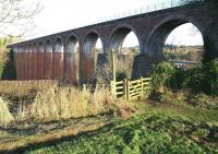 The 1863 railway viaduct at Leaderfoot, photographed looking north towards Earlston on 27 December 2016. Part of the 1973 road bridge that carries the A68 across the River Tweed can be seen through the arch on the right.<br><br>[John Furnevel&nbsp;27/12/2016]