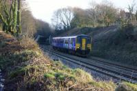 A New Year's Day service from Bolton to Blackpool exits the cutting at the west end of the Chorley Tunnel. Recent vegetation removal in preparation for electrification has opened up this view.<br><br>[John McIntyre&nbsp;01/01/2017]
