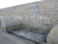 A section of track on Porthcawl Harbour wall.<br><br> The plaque reads,<br><br> 'The Duffryn Llynvi and Porthcawl Railway Company 1825 - 1860<br><br> The dock and horsedrawn tramroad from Duffryn Llynfi and Maesteg built by the company provided the outlet to the sea for the early iron and coal industries The rails below are the last section of the tramroad still in position.'<br><br>[Alastair McLellan&nbsp;02/01/2017]