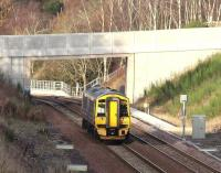 Less than half a mile north of Tynehead station, just prior to crossing the Tyne Water, the Borders Railway runs below a road bridge linking Halflawkiln Farm and the B6367. On the afternoon of 27 December 2016 ScotRail 158735 is seen here about to pass below the bridge with the 1259 Tweedbank – Edinburgh.   <br><br>[John Furnevel&nbsp;27/12/2016]