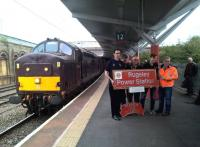 I wonder where they've been? Passengers on the 'Cliffe Hopper' railtour [see image 57204] pose with a nameplate which they just won in a charity auction. The locomotive is 37.668.<br><br>[Ken Strachan&nbsp;07/10/2016]