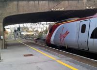 An up Pendolino seems to be staring wistfully at the former signal box and the non-electrified Leamington line.<br><br>[Ken Strachan 26/11/2016]