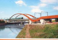 A photograph of a Network Rail billboard outside one of the Ordsall Chord worksites which shows what the bridge over the River Irwell will look like when completed. Compare with the earlier aerial view [see image 15343]<br><br>[John McIntyre&nbsp;10/01/2017]