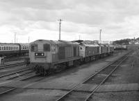 Passing stabled locos at Thornton Depot including 20202, 25066 and a couple of sisters. Seen from the Branch Line Society's Lothian & Fife Wanderer on 23 August 1980 which was returning from a visit to Westfield.<br><br>[Bill Roberton&nbsp;23/08/1980]