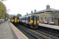 With the chord to the Copy Pit line reinstated Todmorden now sees four trains an hour in each direction. Three of these go to Leeds by either Bradford or Dewsbury and the fourth runs to Burnley and Blackburn. 150218 and 155347 call at the station on 21st October 2016.   <br><br>[Mark Bartlett&nbsp;21/10/2016]