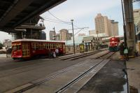 New Orleans street car No 462 departing St Julia station on the Riverfront line as loco No 1505 of the New Orleans Public Belt Railroad brings a freight train along the Mississippi riverfront towards the dock area.<br><br>[Alastair McLellan&nbsp;09/11/2016]