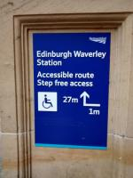 This notice at the foot of the stairs on the Calton Road entrance to Waverley and is aimed at wheelchair users. I can't help thinking though that anyone who needs to be told to turn left for 1 metre must be so short-sighted that they couldn't even see the notice, let alone read it ...<br><br>[David Panton&nbsp;07/01/2017]