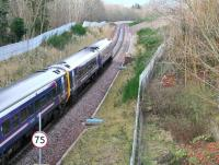 An Edinburgh bound train on the Borders Railway heads towards the Gore Glen shortly after restarting from Gorebridge and passing below Station Road on 8 January 2017.<br><br>[John Furnevel&nbsp;08/01/2017]