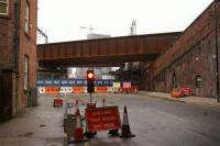 Looking south down Water Street, with the L&M Liverpool Road station above to the immediate left, the deck of the new Ordsall Chord bridge and beyond it the replacement bridge on the line from Castlefield Jct to Ordsall Jct.These two bridges were installed during a closure over Christmas and New Year.<br><br>[John McIntyre&nbsp;10/01/2017]