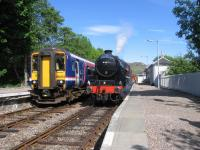 Mallaig-bound Jacobite crosses a ScotRail service at Arisaig on 3rd June 2016.<br><br>[David Spaven&nbsp;03/06/2016]
