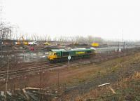 Sunday morning activity at Millerhill on 22 January 2017 as Freightliner 66551 ambles through the yard. Works in connection with the new ScotRail EMU depot are underway in the background, with the former locomotive servicing facilities having recently been removed.<br><br>[John Furnevel&nbsp;22/01/2017]