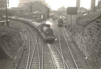 Ex-Caledonian 0-6-0 57603 passing West Street Junction on 29 March 1956 with an eastbound goods train on the approach from Terminus Junction. To the right is the remains of the 1840 P&G route to Windmillcroft Quay, a replacement for the Govan Waggonway of the 1770s. [Ref query 630]   <br><br>[G H Robin collection by courtesy of the Mitchell Library, Glasgow&nbsp;29/03/1956]