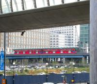A train on the Docklands Light Railway calls at West India Quay in the summer of 2005 with a city bound service. The station stands on the north side of the old West India Docks, some 200m east of the site of the original London & Blackwall Railway West India Docks station, closed in 1926. <br><br>[John Furnevel&nbsp;/07/2005]