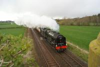 Ex LMS 4-6-0 no.46115 Scots Guardsman approaches Curthwaite between Wigton and Carlisle while working a railtour on 16 April 2016. The former station is behind the photographer.<br><br>[John McIntyre&nbsp;16/04/2016]
