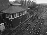 Ashington signal box looking north in 1987. The line to the left ran to Ashington Colliery and the Butterwell Disposal Point. Seldom used, the connection has been severed allowing box closure in 2010. The double track to the right ran to the Lynemouth Aluminium Smelter and Lynemouth Power Station, having started life as the Newbigging Branch.<br><br>[Bill Roberton //1987]