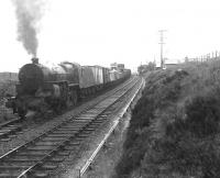 Horwich Mogul 42918 with a westbound goods at a wet and lonely Loch Skerrow station on 14 July 1956. The train is on the up line at this point to permit overtaking. [Ref query 678]  <br><br>[G H Robin collection by courtesy of the Mitchell Library, Glasgow&nbsp;14/07/1956]