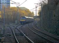 Viewed under the A723 road bridge, a Dalmuir - Larkhall service heads east from Hamilton Central on to the the single track section and into the winter sunshine. <br><br>[Colin McDonald&nbsp;27/01/2017]