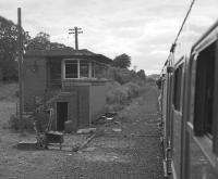 View from the Branch Line Society's Lothian & Fife Wanderer on 23 August 1980 of the closed Oakley signalbox, replaced by a ground frame.<br><br>[Bill Roberton&nbsp;23/08/1980]