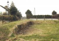 The remains of the former terminus at Port Carlisle in the spring of 2002. The area beyond the fence is now the car park for the local bowling club, while the sign on the left belongs to 'The Hope & Anchor'. [Ref query 697]<br><br>[Mike Shannon&nbsp;/03/2002]