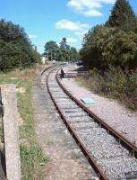 Looking along the former Cirencester platform at Kemble railway station on the 30th of August 2016, now an engineer's siding which peters out after a short distance beyond the platform in a station car park.<br><br>[Alan Cormack&nbsp;30/08/2016]