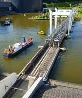 Traffic jam of model boats while a passenger train crosses the lifting bridge at Madurodam.<br><br>[Beth Crawford&nbsp;07/09/2016]