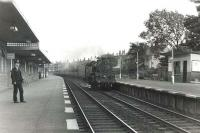 Standard class 4 2-6-4T 80000 photographed at Corkerhill station on 30 June 1959 with a St Enoch - Largs train. 'Corkerhill railway village' and signal box can be seen in the background. [See image 19972] <br><br>[G H Robin collection by courtesy of the Mitchell Library, Glasgow 30/06/1959]
