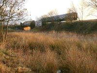 A 2014 winter morning view across what became the carriageway of the new section of the M8 as a class 156 DMU approaches Bargeddie.<br> <br><br>[Colin McDonald&nbsp;30/01/2014]